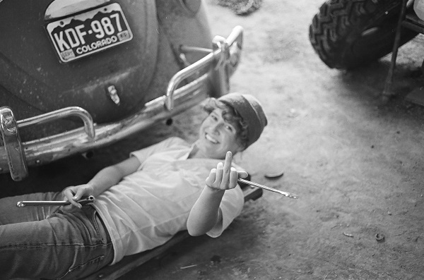 India Wood replacing the alternator on her VW in 1985