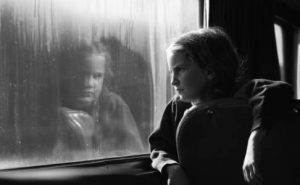 India looking out a train window in about 1976. Photo by Nancy Wood.